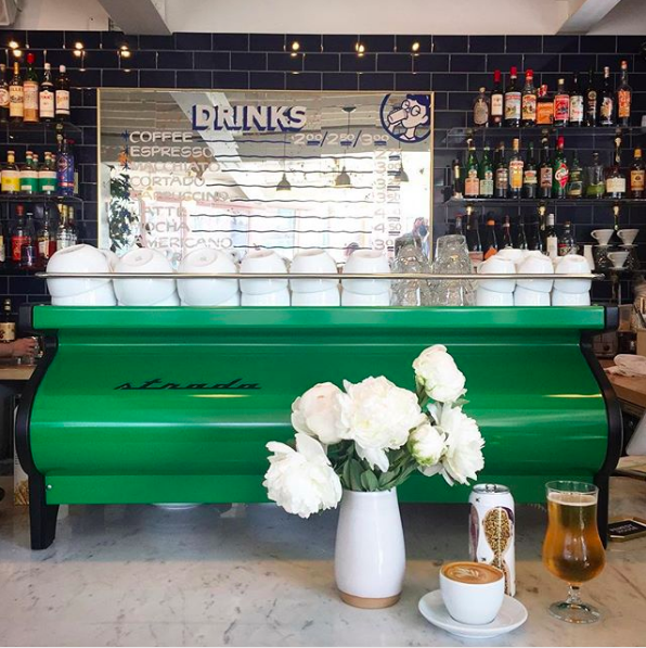 Guests are instantly drawn to Remedy House's signature green espresso machine.
