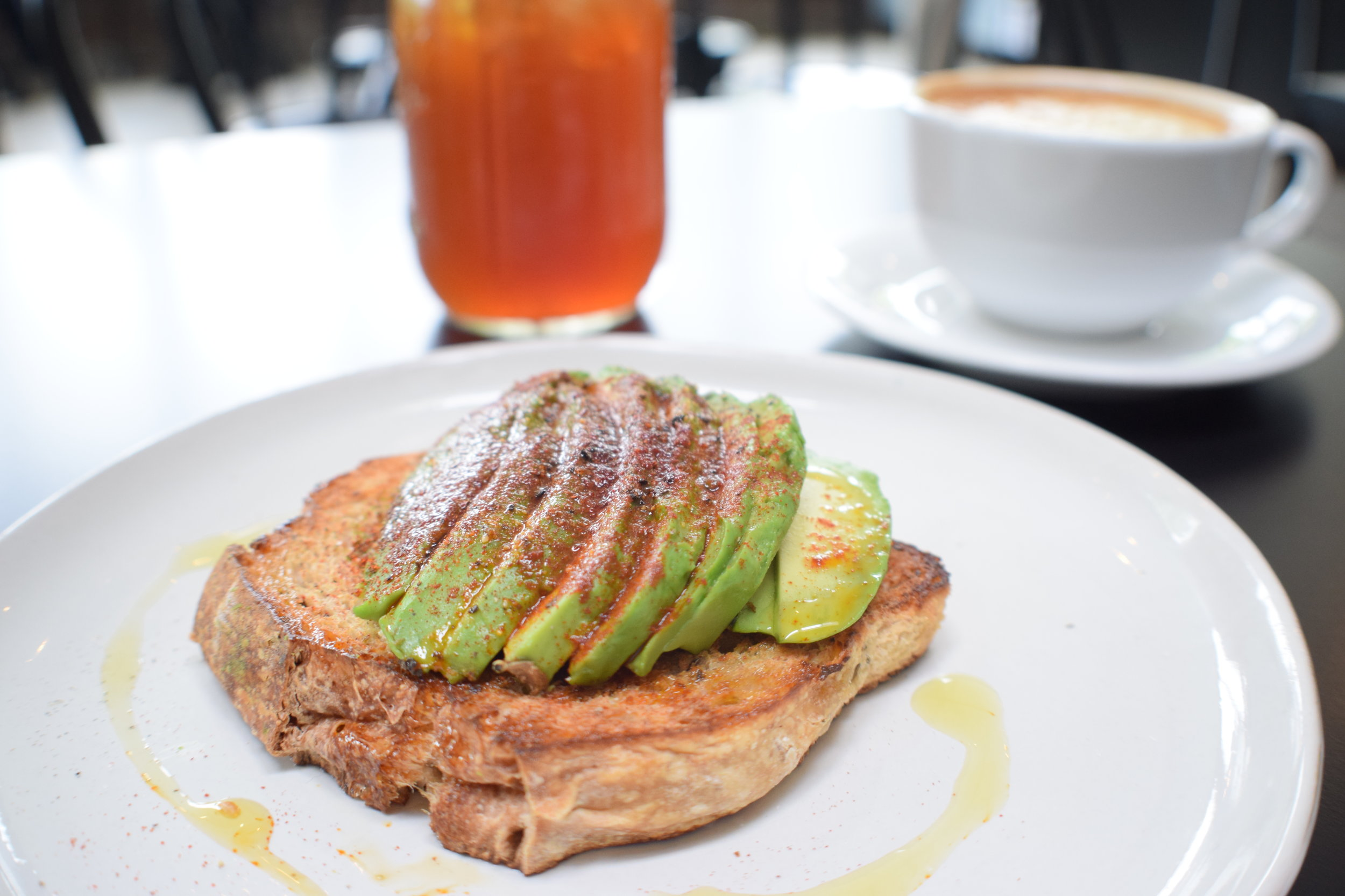 Tipico's Avocado toast on Breadhive bread pairs perfectly with a glass of Cold Brucha.