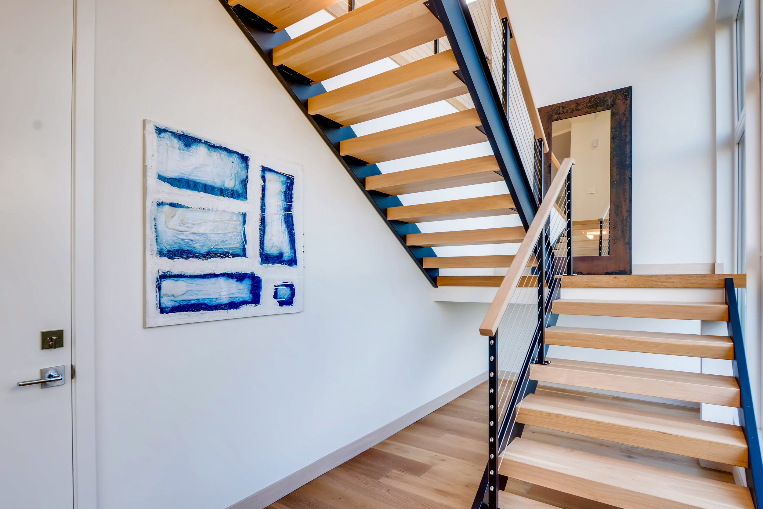 12410 Holmes Point Drive NE-print-032-22-Stairway-4200x2801-300dpi.jpg