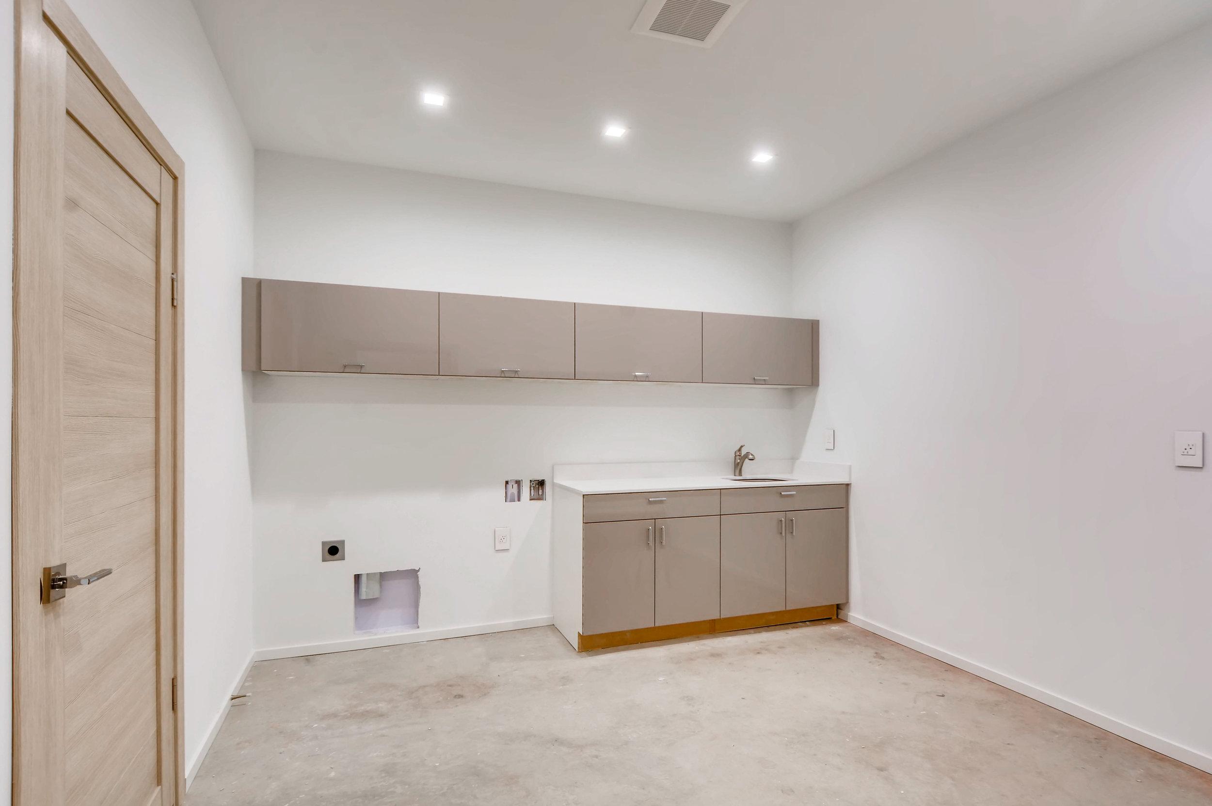 12410 Holmes Point Drive NE-print-033-28-Lower Level Laundry Room-4200x2795-300dpi.jpg