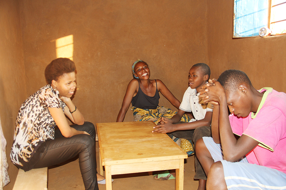 Livine with her mother and brothers in the home she grew up in.