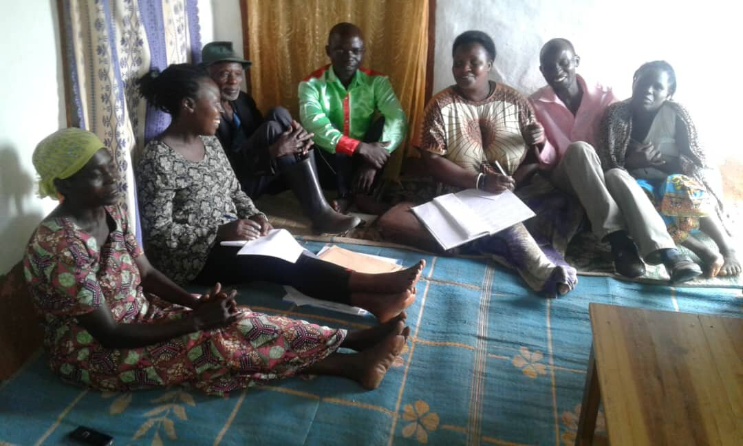 The group of parents in the Gihinga sector meet with Veneranda