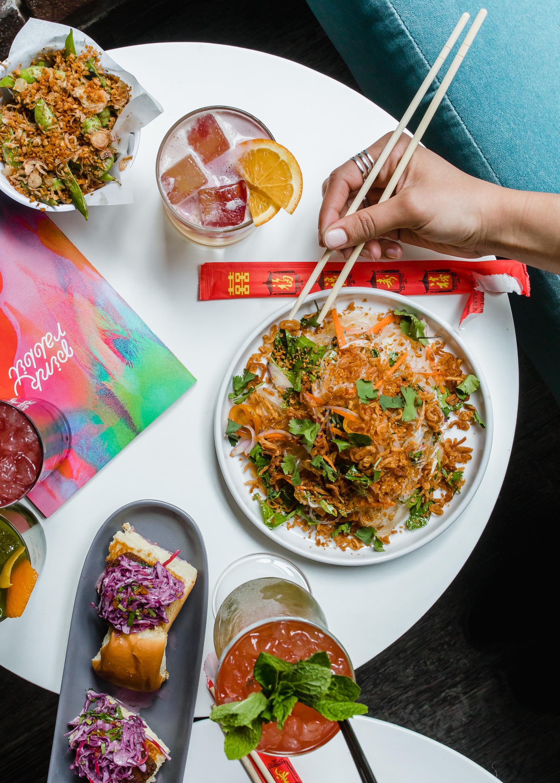 Wun Sen Noodles Salad - lime, fish sauce, chili, pickled garlic, shallot, cilantro, celery leaf, tomato, garlic, fried shallot