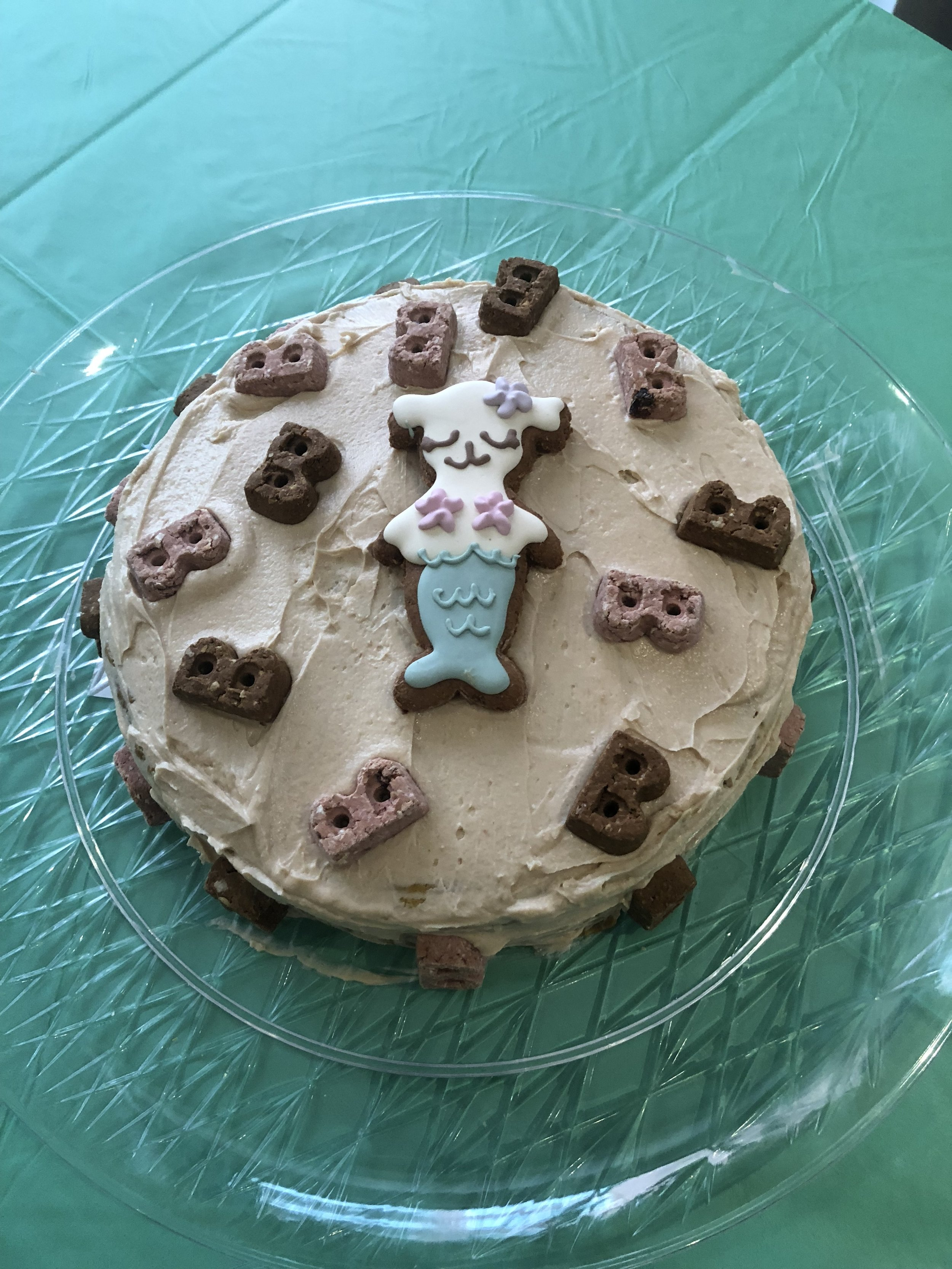 We had lots of human snacks and I made a doggie cake. The recipe is  linked here  (thanks for the recco @CoopertakesBrooklyn). The treats are from  Bocce's Bakery  and the mermaid is from our  Dapper Dog Box .