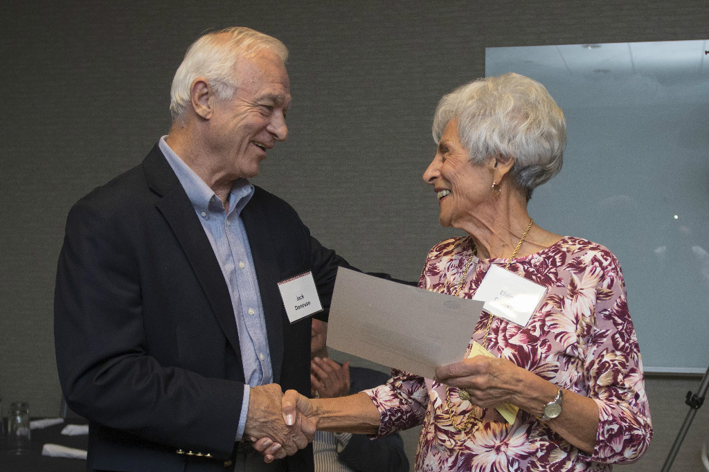 Jack Donovan, Class of 1962, acknowledges Elain DiCicco of The Scholarship Fund