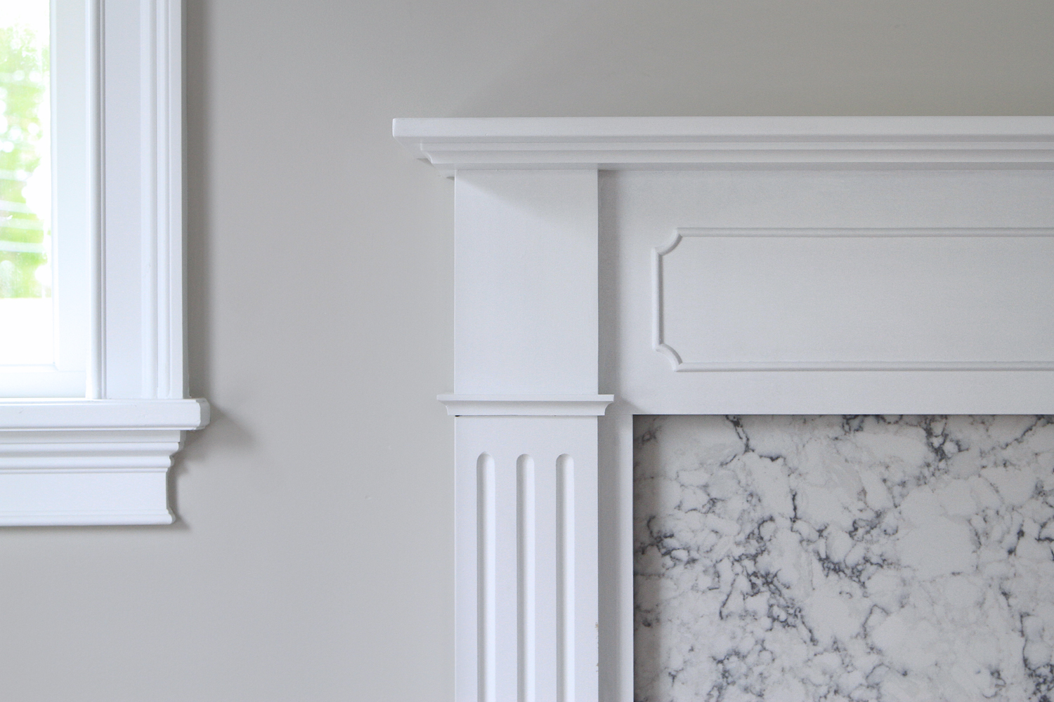 A classic mantel meets a marble fireplace surround… -