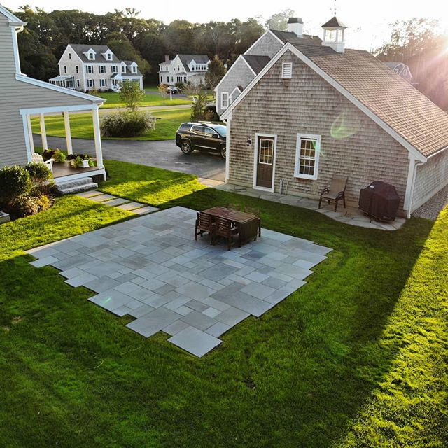 Bluestone patio install with stepping stone path and granite steps. Great project, working with Sean and Amanda.  We met in the spring and scheduled the work for mid summer and had it done for Labor Day.  Sometimes schedules get delayed due to any number of reasons.  That said, there's nothing more rewarding than working for good people... And the drone shots are an added bonus!  Thanks for the 📷@horrigan23! #bluestone #patio #granite #hardscape #lamdscaping #dgdesigninstall