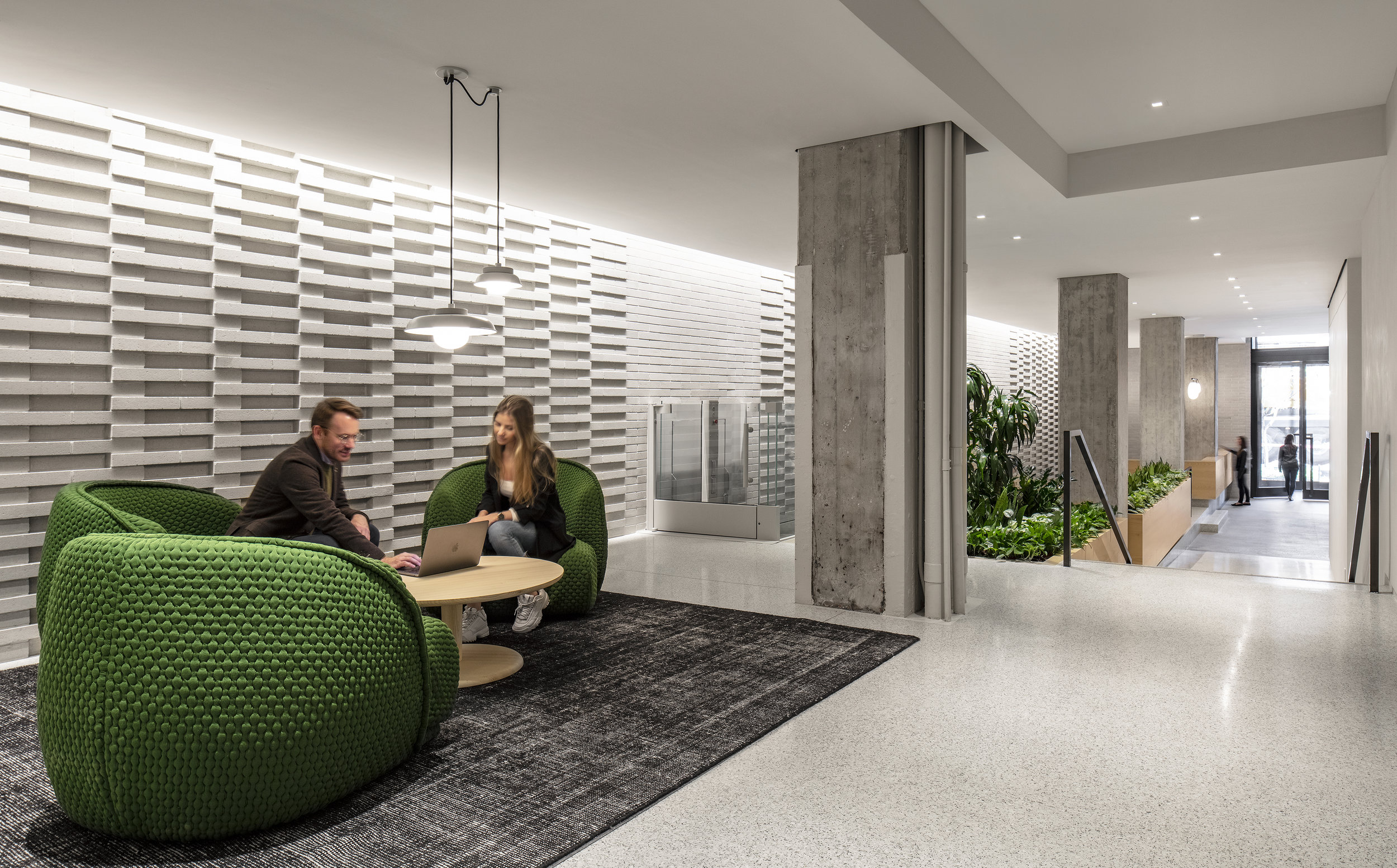 At 155 Avenue of the Americas, an elevation change and comfortable furniture create an ideal environment for an out-of-office meeting.