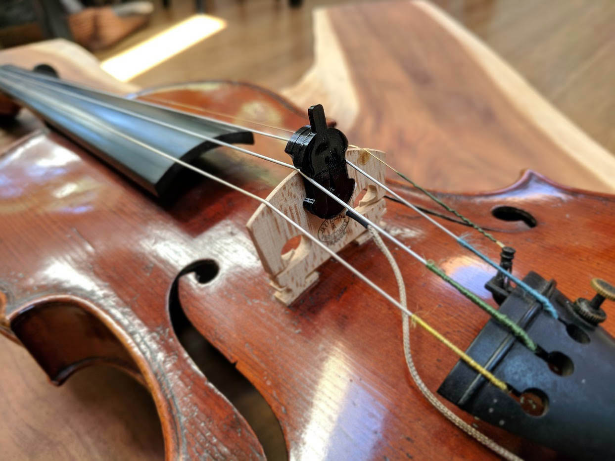 Viol Orchestral Mute mounted for balanced mezzo piano. The viol mute can be placed anywhere across the bridge to fine tune the mezzo piano effect across the instrument's spectrum.