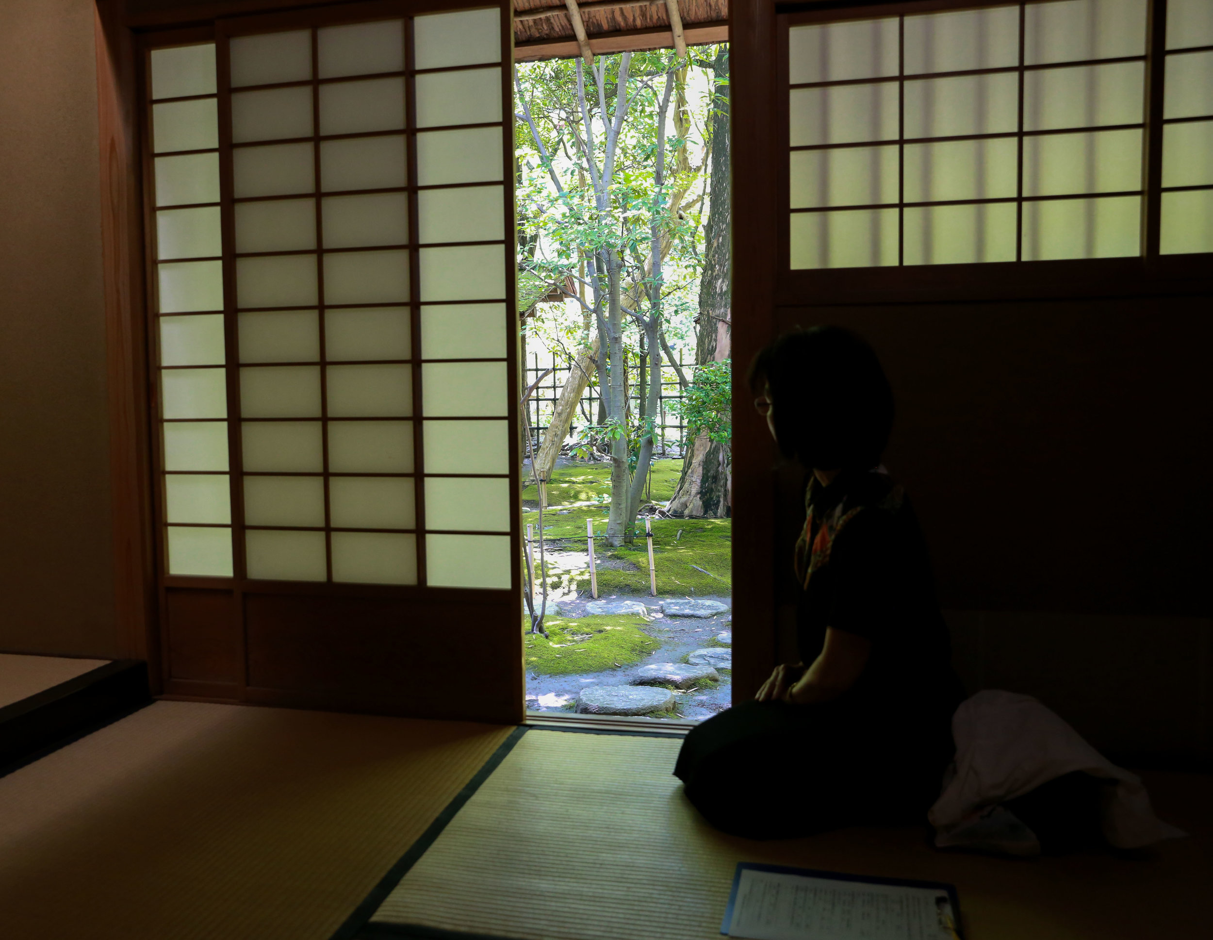A woman enjoys the view outside the chashitsu at Rakusui-en in Fukuoka, Japan, June 22, 2018.