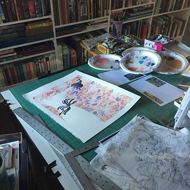 i paint at home, surrounded by my books. so here's my little corner of the world, you can see my paper paint palettes (great for re-using spots of color), my tins full of gouache, and the original pattern drawing on tracing paper.
