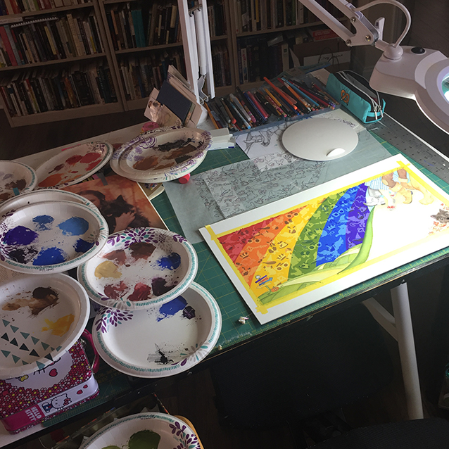 here's a view of SOME of the paper plates i mixed our paints on… i keep them from each painting because i can reuse the puddles for other smaller areas, particularly on the figures which i don't paint opaquely.