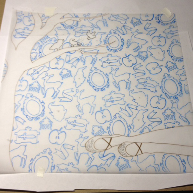 once i narrowed down which story icons to use in the background, i created my pattern and re-traced it (with transfer paper in between) to transfer blue lines down to my illustration board.