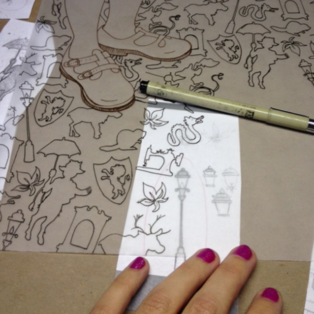 tracing the lamp post– filling in the background pattern with my final icon sketches so the background is FULL.