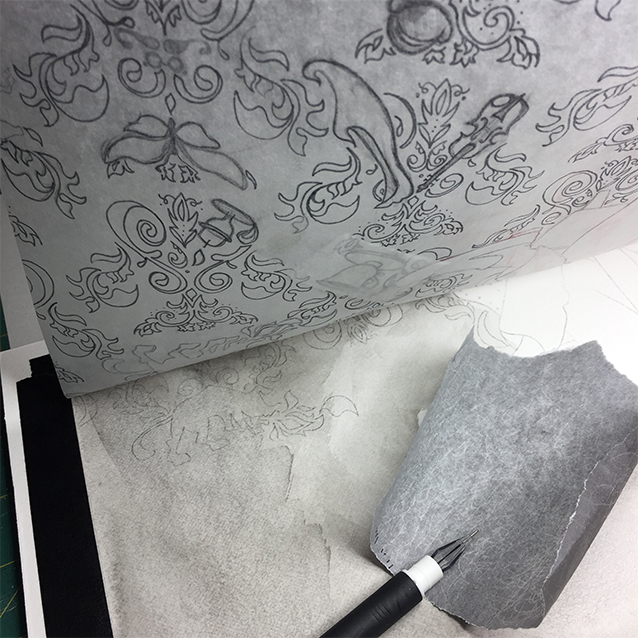 once i finalized my pattern and hidden-image drawing on tracing paper, i stained my illustration board with a light wash of india ink to give it that creepy foggy london effect. then i taped the drawing to the top of my board, and using transfer paper, re-traced the drawing to leave me a light grey line where i was to paint in the final image.