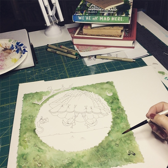 once i had my final sketch, i transferred it to watercolor paper and started painting in layers of green foliage for the hedges.