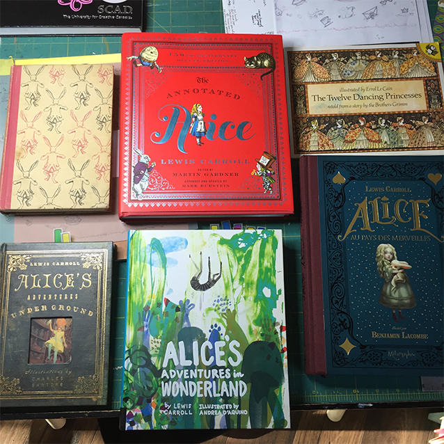 """just a few of my alice editions. """"alice adventures underground"""" was really interesting as it's a printing of the original manuscript carroll gave to alice liddell, not how he edited it when people told him he should publish it. (he had to pay for his first print run, by the way. and tenniel was so unhappy with the plates from his etchings (the first and last children's book the editorial cartoonist ever illustrated!) that he demanded a reprint. so they stamped them defective and shipped them to america. if you have that FIRST edition, oh how i envy you!!"""