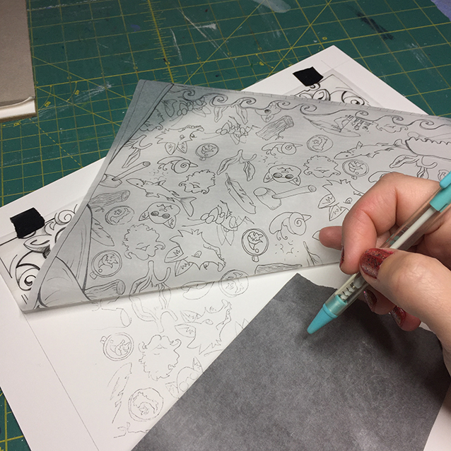 once the layers were done, i needed to paint the background pattern. so this is how i transfer it- with my pattern drawing on a piece of tracing paper taped to my illustration board… and then pressing down with my ink-less hello kitty pen with transfer paper in between to leave grey lines i can paint around.