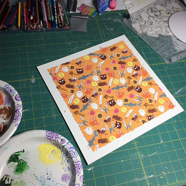 here's zoomed out for a bit of scale. the orange square (background pattern painting) is 11″ square. and yes, i mix my paints on paper plates.