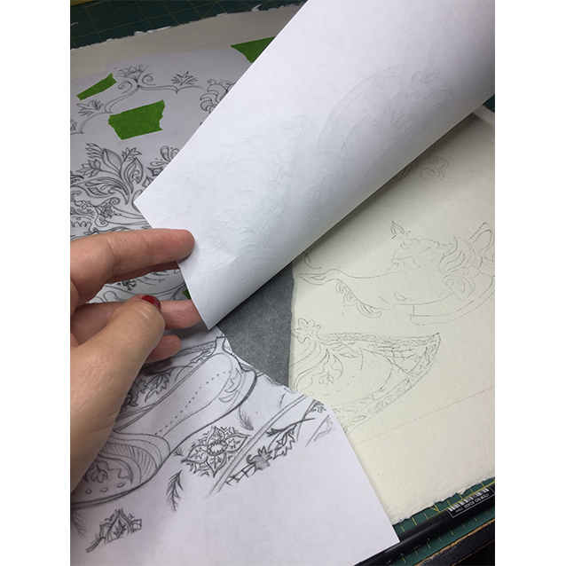 once i have my full drawing, i blew it up to the scale i wanted to paint it (you can see my photo copies spliced together; i'm totally hi*tech over here), and used a piece of graphite paper to transfer all the details down to my watercolour paper.