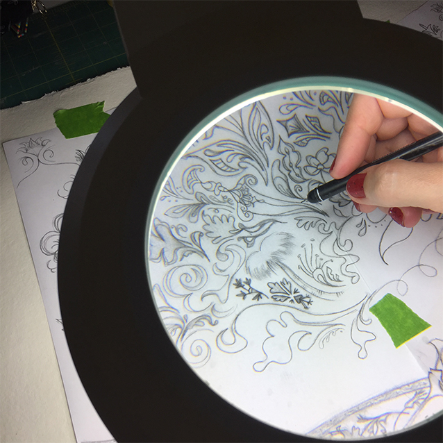 my trusty magnifying lamp, trying to help me not go blind for details as i re-trace my drawing down to the watercolour paper.
