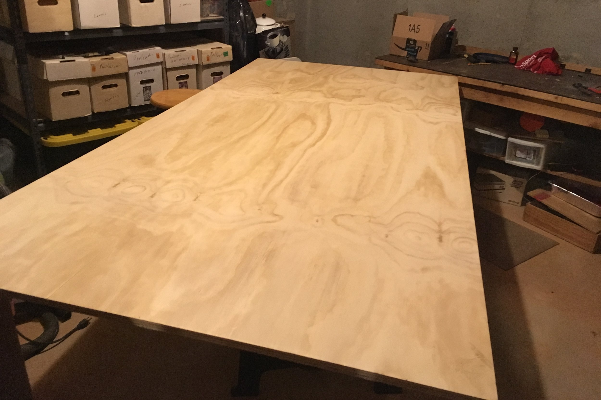 "This is a 5' x 4' piece of 3/4"" pine plywood, which will the be base of the mosaic. I drew the scaled grid onto the surface."