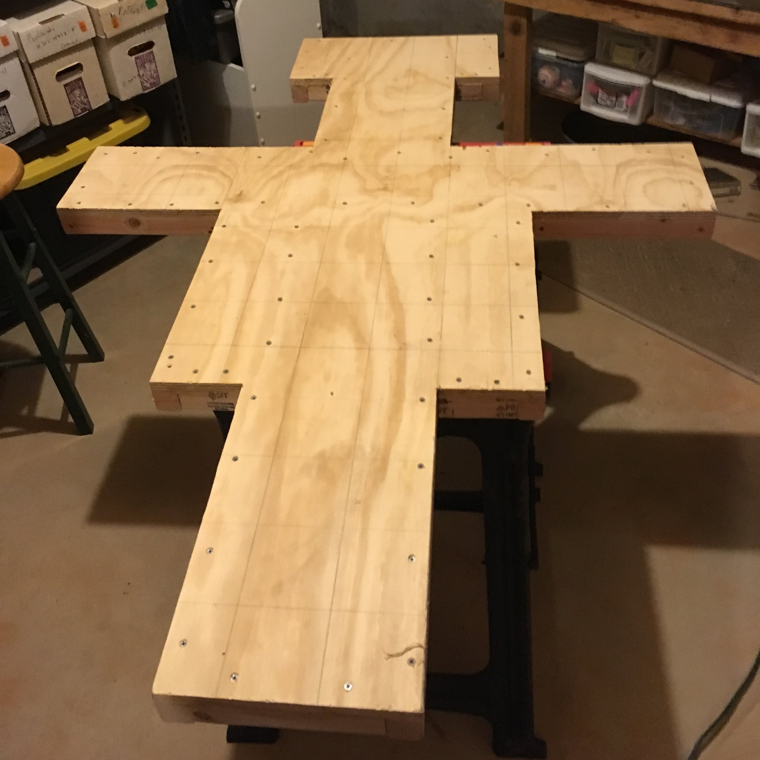 I transferred the scaled grid onto the sheet of plywood and drew the outside of the cross. From there, I trimmed it out, then screwed on a frame on the back for stability. It is important that the plywood doesn't warp or bend, even with changes in temperature and humidity and the stresses of moving and hanging the piece.