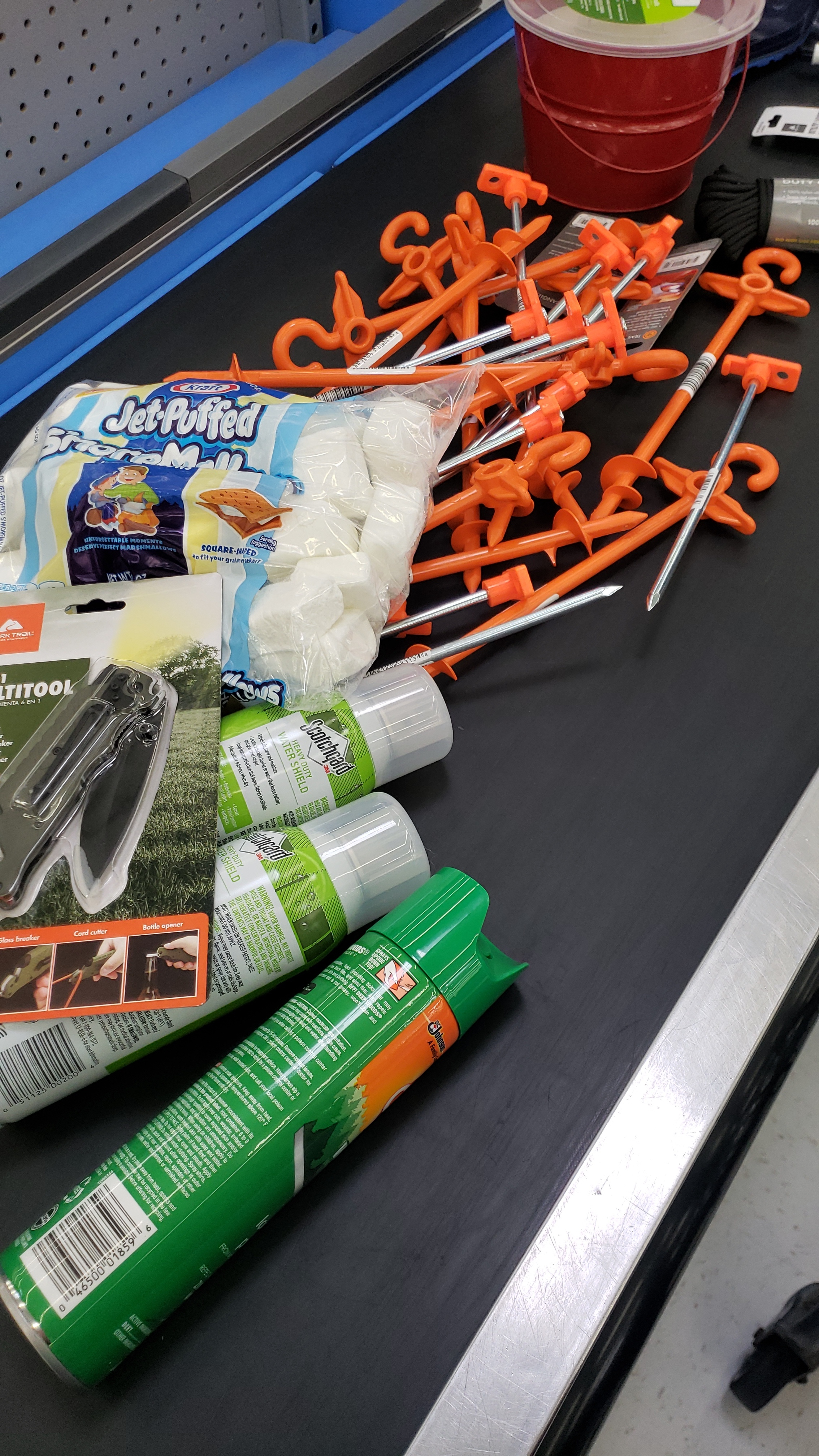 The basics. Storm proof stakes, marshmallows, waterproofing spray, insect repellant, and a spare knife as a spare to my older spare knife.