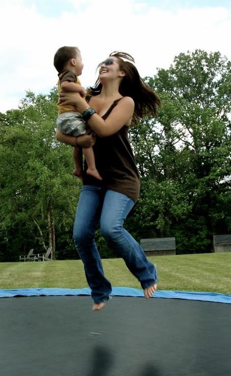 Rachel, jumping and full of joy, with our nephew