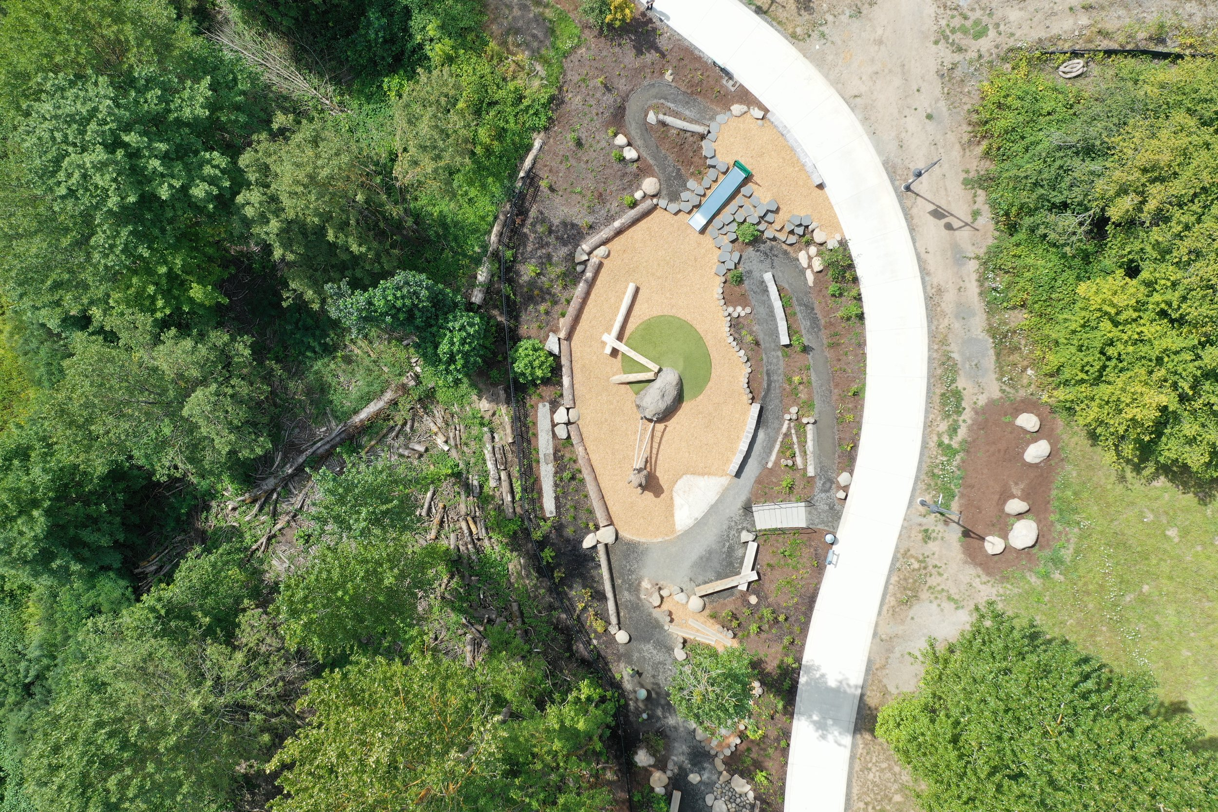 playground, cement pathways, and forest from drone