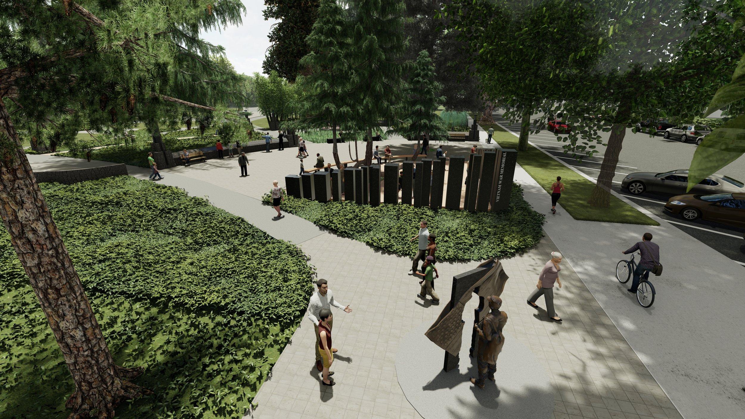 People under pine trees in a Vietnam war memorial