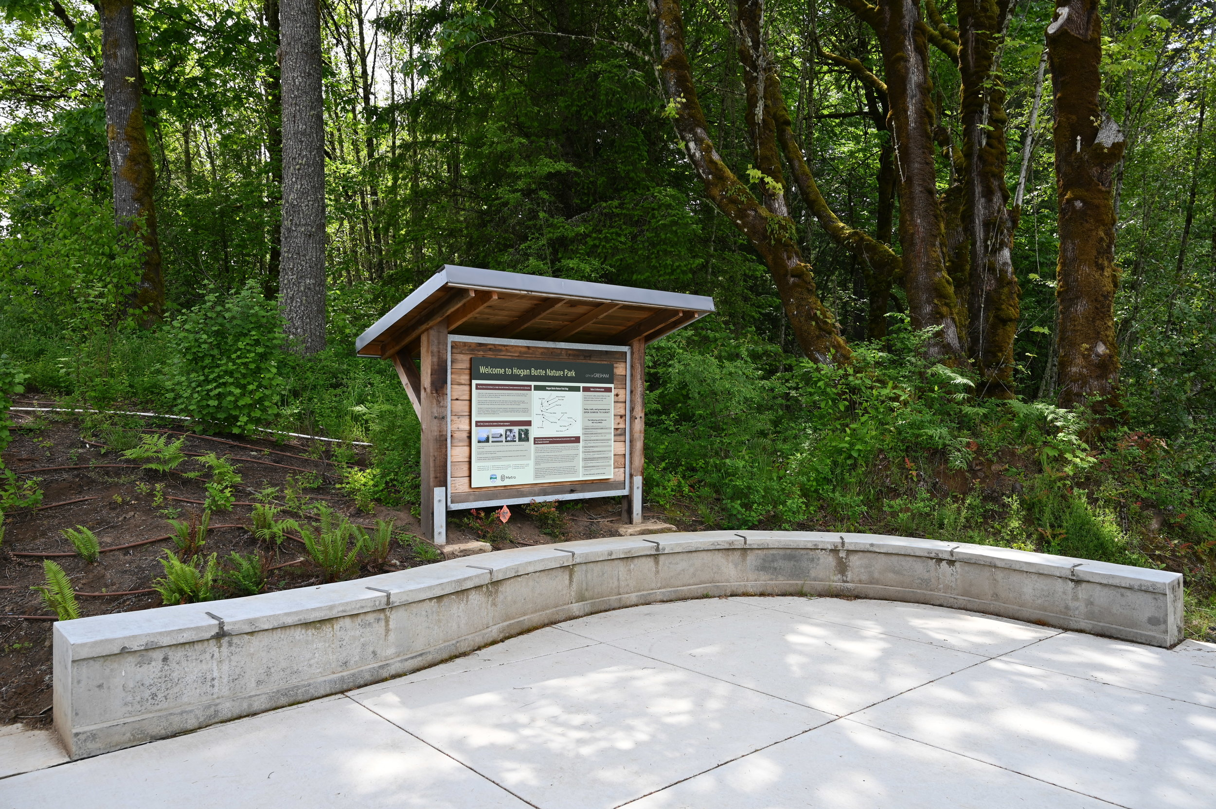 interpretive sign set back from newly poured sidewalk