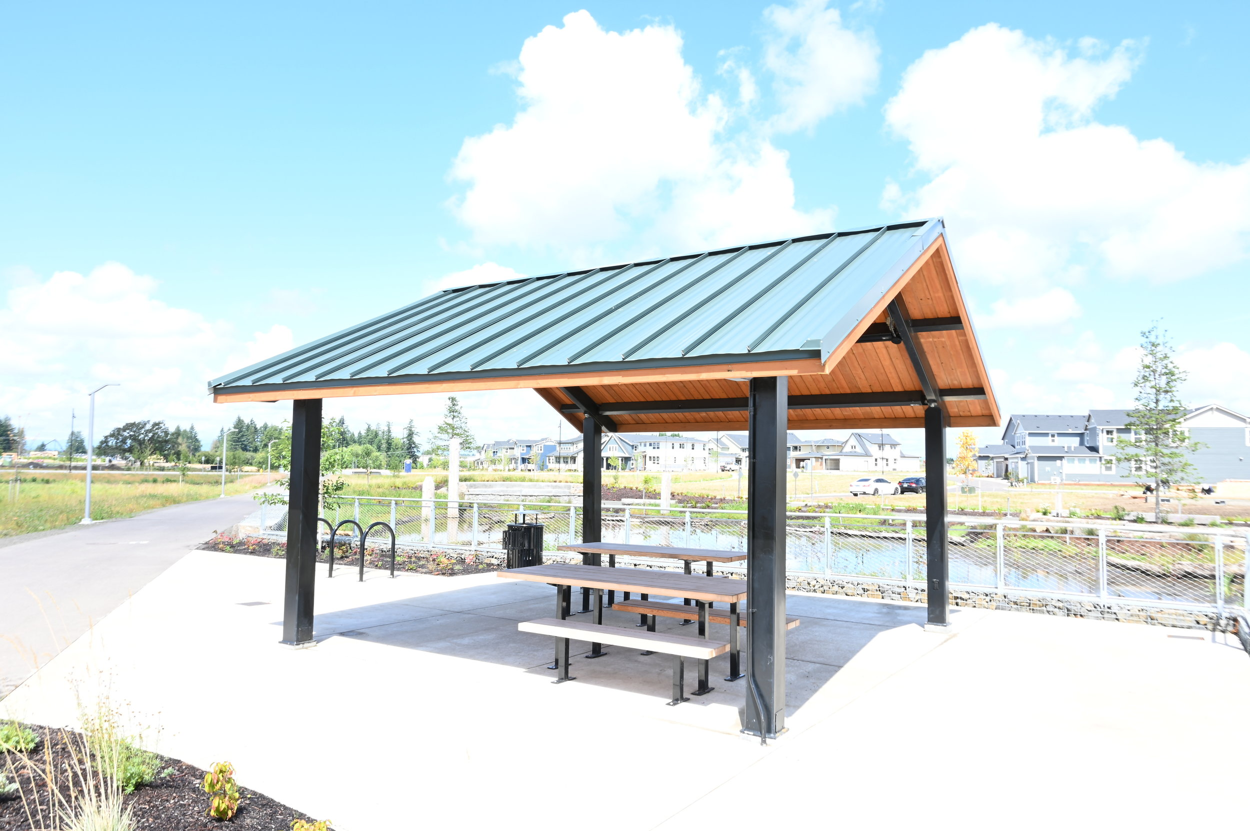 overexposed photo of metal picnic shelter on sunny day