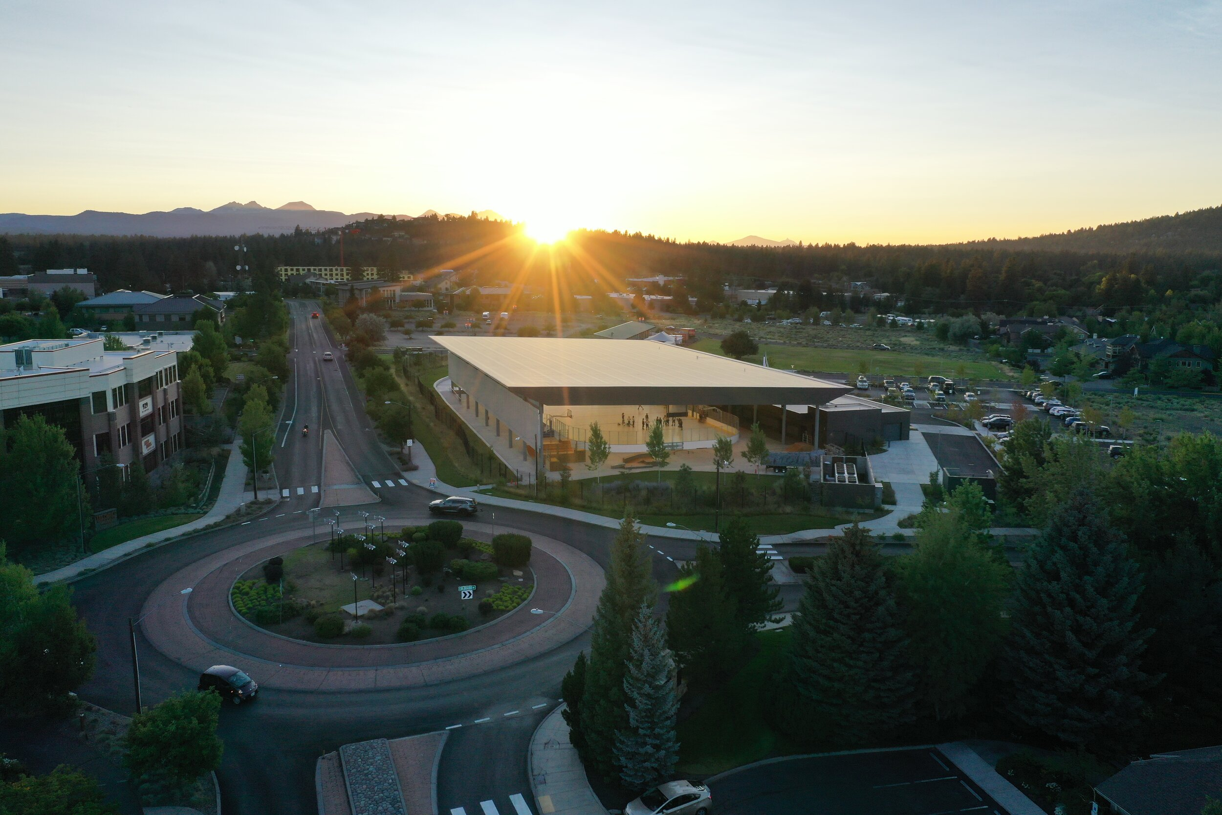 drone photo of Simpson pavillion during sunset, roundabout and cascade mountains in view