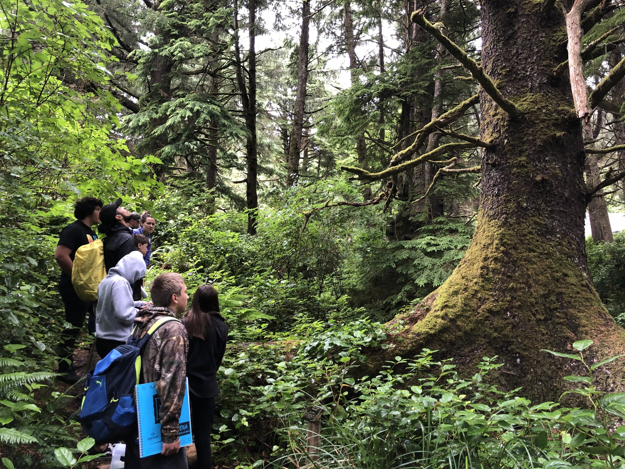 Nadja Quiroz with a group of youth on the Ya'Xaik Trail at Gerdemann Preserve near Yachats