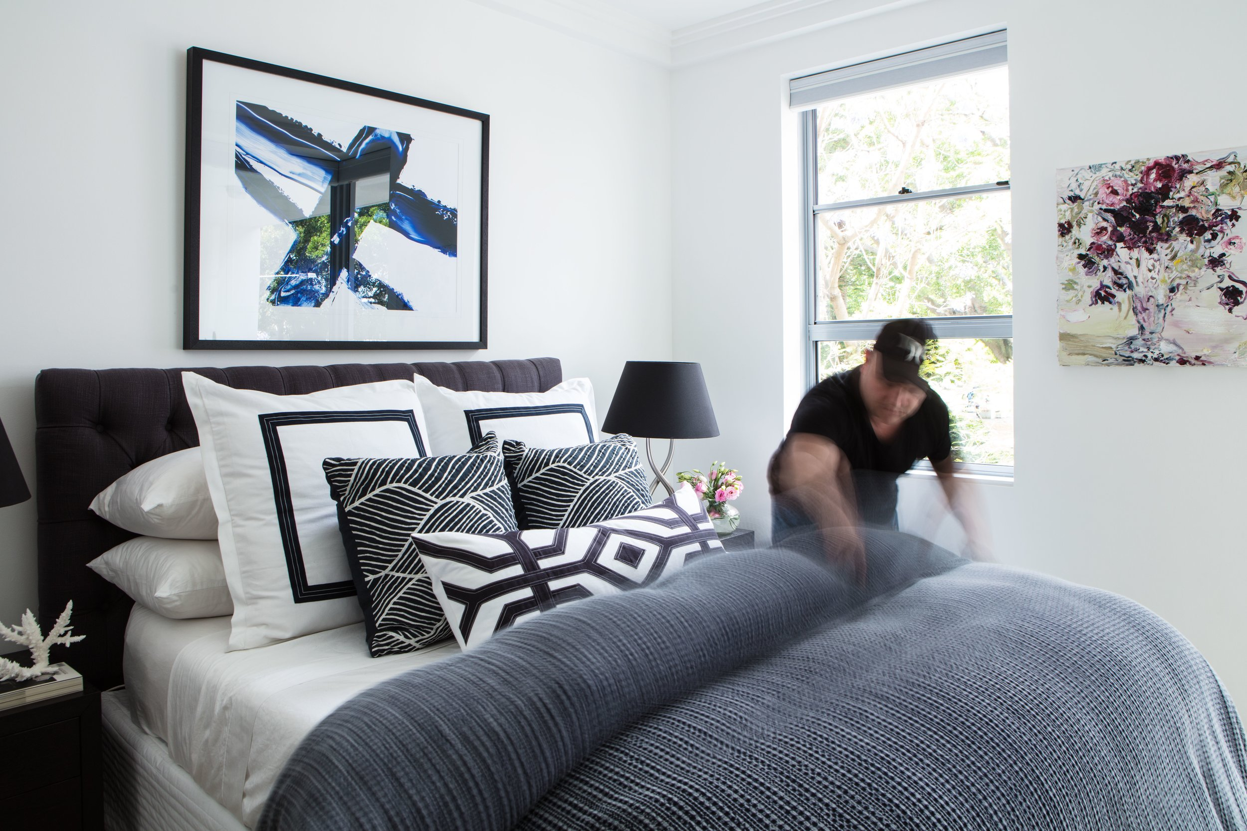Me installing custom bedding in an Inner City Project.