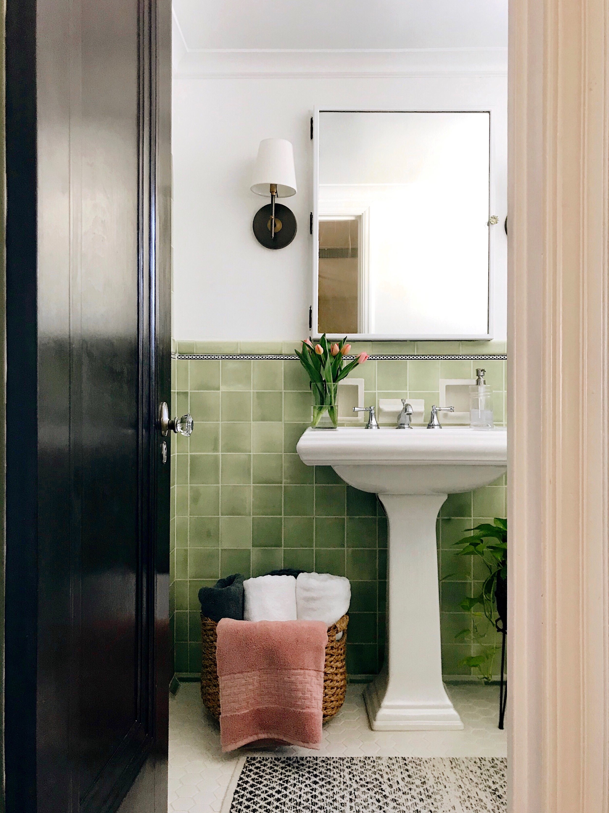 bath towels  here  | pedestal sink  here  | similar basket  here  | floor tile  here