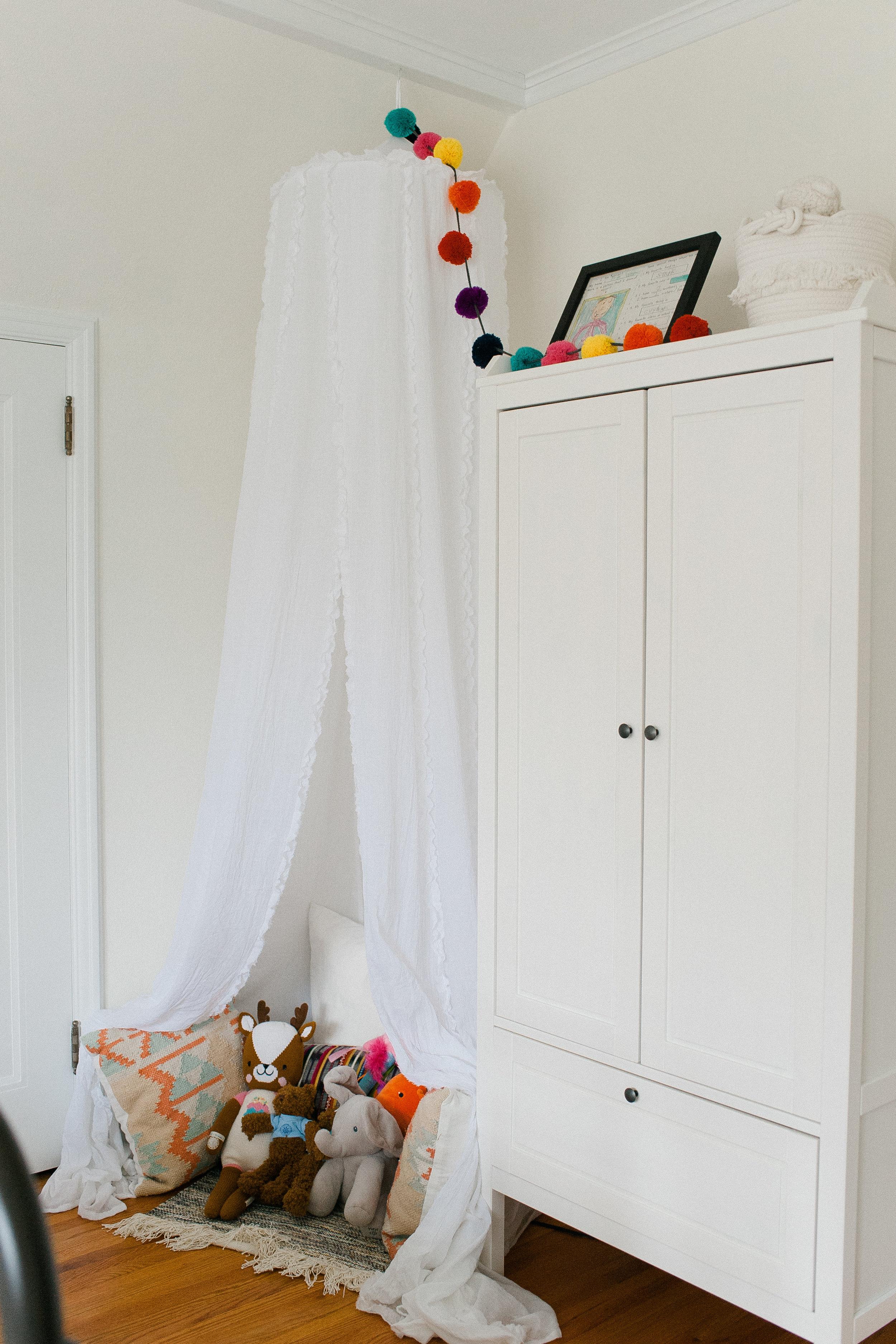 similar wardrobe closet  here  | similar canopy  here  | fabric basket  here