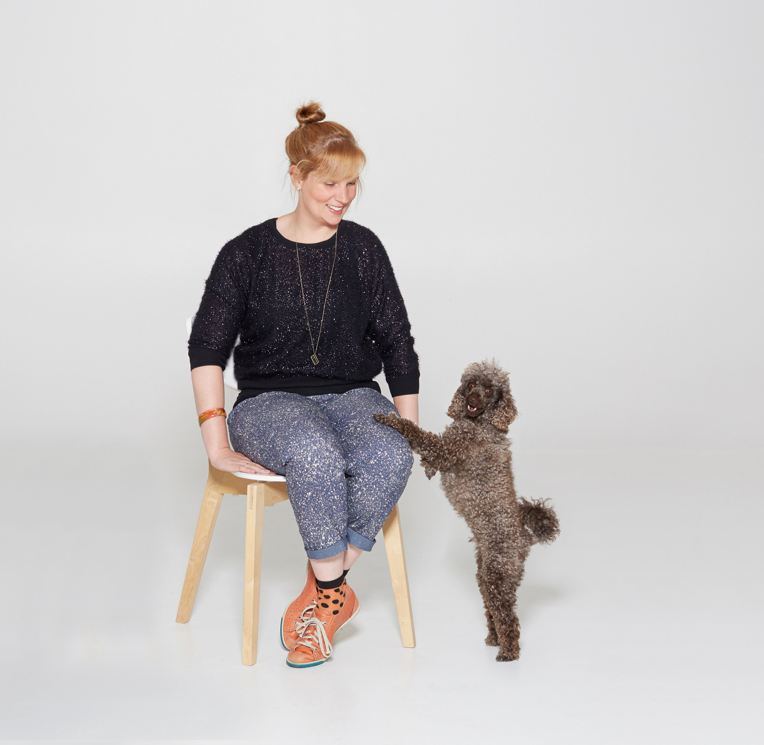 Chelsea, founder of halló cameo and assistant, toy poodle, Benji.