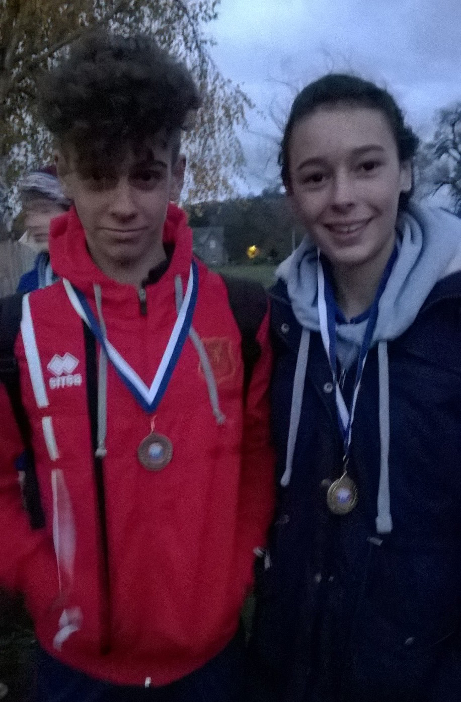 Sam and Tiegan receiving their medals