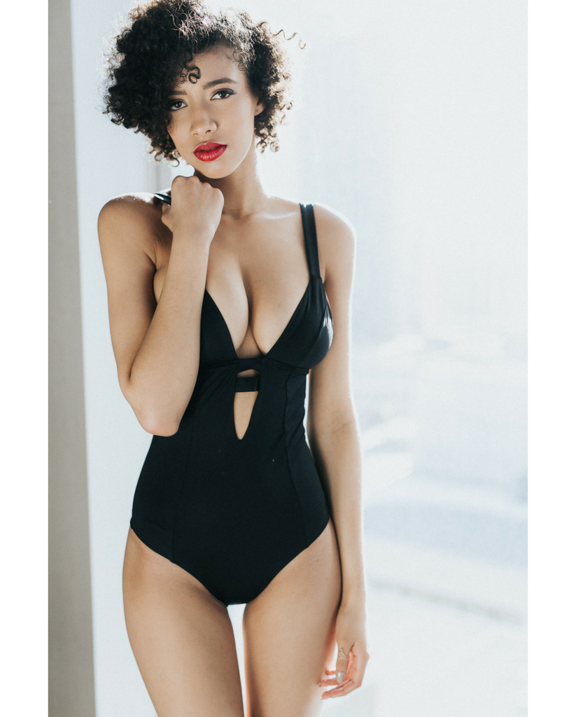 Neutra Maillot One Piece in Black from Azura Bay. Made from EcoLux™ fabric. Ecolux is a superfine jersey with a subtle sheen made with a blend of Repreve® RECYCLED nylon fiber (using discarded fishing nets pulled from our oceans).