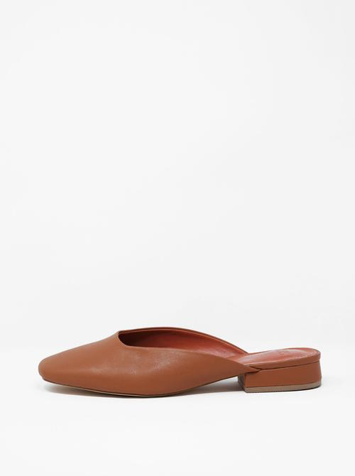 Janis   Caramel - $115Mules aren't going anywhere any time soon. Give your fringe or woven mules a rest and swap for a vegan leather classic this fall.