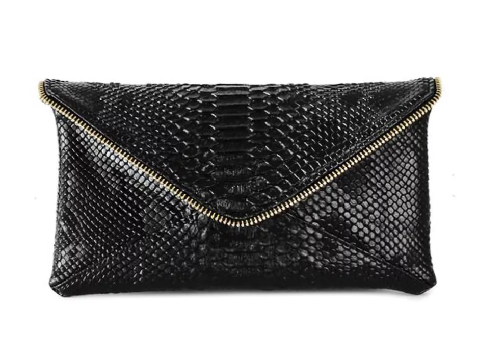 The Standard Zipper Clutch - $138 |Available in vegan white python