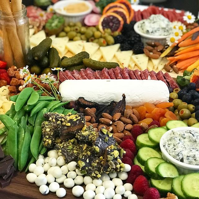 When the bride says she loves pickles, her wedding grazing board has pickles! Grazing tables are a beautiful, on-trend way to feed your guests for far less than typical cocktail-hour fare. 👰🤵 ___________ #cheeseboard #foodie #cheese #cheeseplate #igfood #charcuterie #goopmake #thatsdarling #darlingweekend #marthafood #latimesfood #fromage #cheeselover #f52grams #budgetbride #wedding #thatcheeseplate #weddingfood