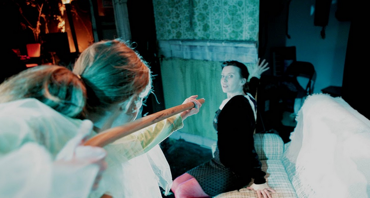The ghost of Carson (Kathleen Philips) taunts Carlyn (Magali Meagher) in The Rat King Rock Opera. Photo by Lee Towndrow (2006)