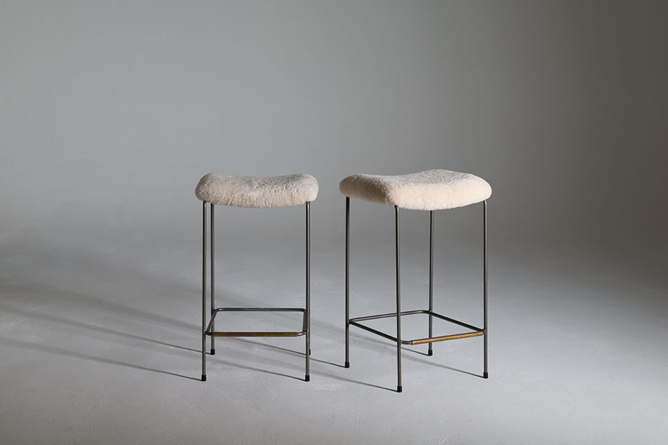 The Dita Stool with custom sheepskin upholstery