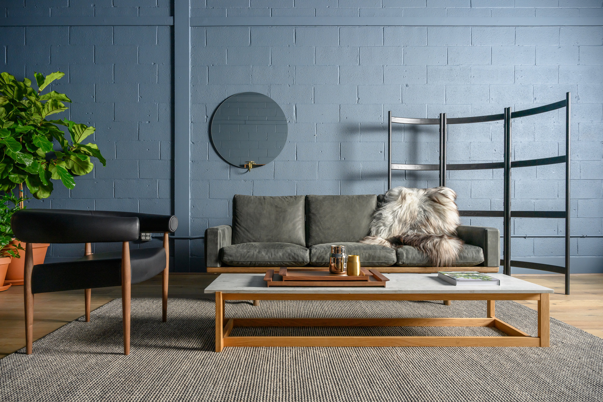 The GE236 Sofa by Hans Wegner and, the Ring Chair by Nanna Ditzel both for Getama. And the Klassik Coffee Table in marble and oak from Klassik Studios. Miro Miro Mirror from Friends and Founders, The Shoji screen designed by Gabriel Tab for Ariake.