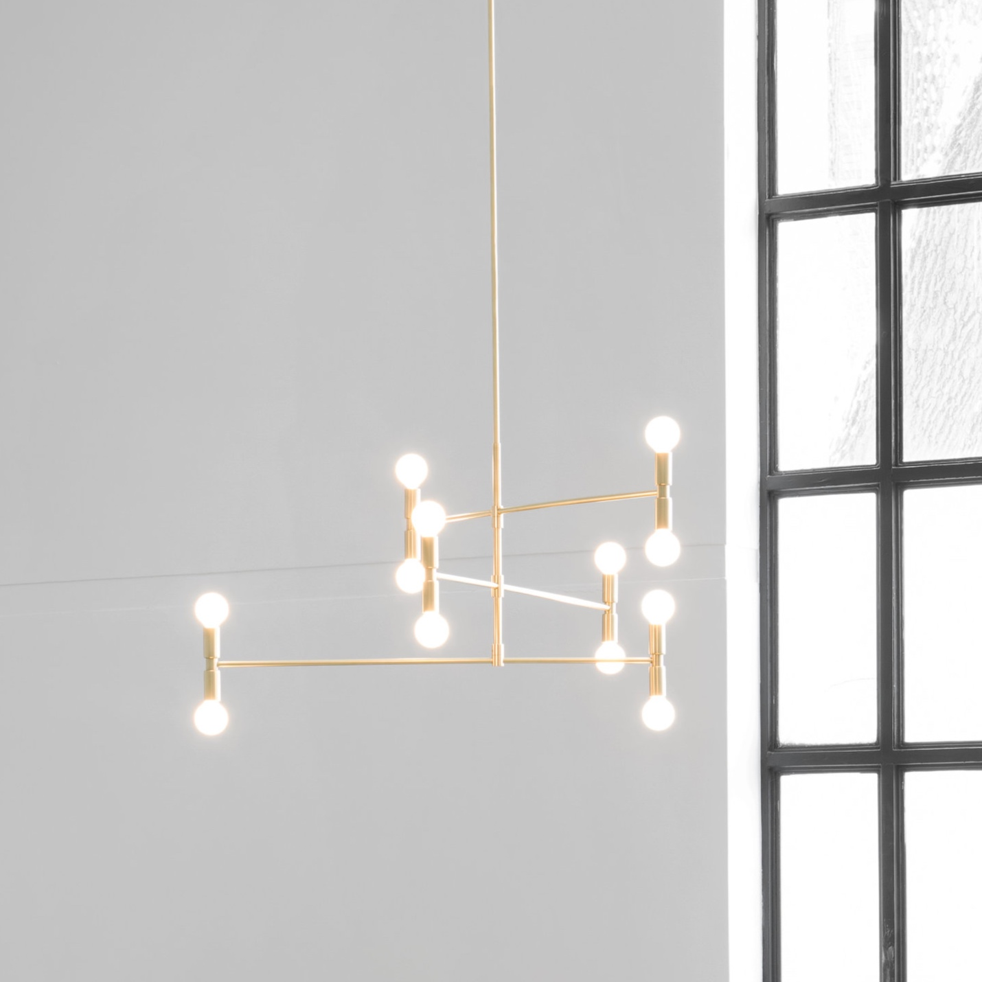 Dot - The Dot Collection combines the directness of exposed, spherical bulbs with the rich materiality of brass. Focused, geometric compositions contain these two features, balancing line, surface, and luminous points. The result is a collection of lamps based in the reflectivity of brass—lamps that are both atmospheric and firm.