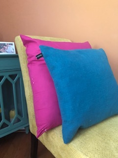 These furiously happy turquoise & pink pillows.  -