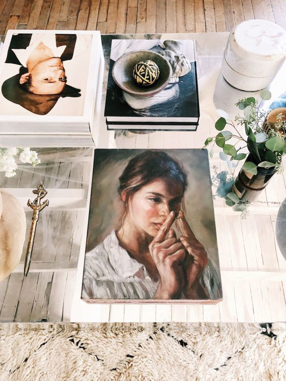 Photograph Design   HGTV Leanne Ford placing vintage portraits face up on the coffee table — inspired!